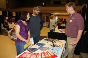 Pearl residents Michelle Widener and her husband Travis Widener,  a Navy veteran who is now in the Air National Guard, talk to Hinds Community College Veterans Services coordinator Ryan Braswell about some of the financial benefits of attending the college.