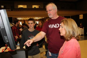 Caleb Courtney of Florence, left, and his mother Patti Courtney talk to Music Industry instructor Knight Bruce about the Hinds Community College Raymond Campus program.
