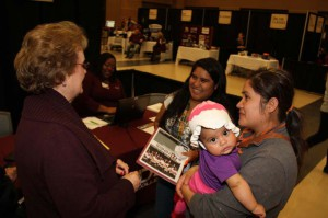 Erika Velazquez of Morton, center, plans to move in with her sister Lucy Velazquez of Pearl and her niece Luz Marie to attend Hinds Community College's Rankin Campus this fall. Jean Vaughan, Rankin Campus Admissions processor, left, talks Erika through the process.