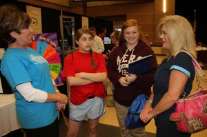 Rankin Campus instructor Carley Page, left, talks to Courtney Bounds, Carly Bounds and their mom Michelle Bounds, all of Brandon, about Hinds Community College. Carly plans to enroll in fall classes.