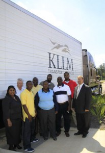 Dr. Joyce Jenkins, dean of the Raymond Campus Career-Technical Education division, left, and Dr. Chad Stocks, assistant dean, far right, pose with the first class of KLLM and Hinds students in 2013.