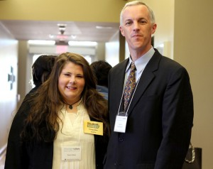 Emilee Ware of Raymond, left, a member of Hinds Community College's Student VOICES group, state Sen. David Blount of Jackson