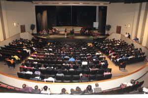 Students seated inside of the Bobby G. Cooper Fine Arts Center for the closing session