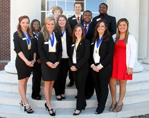 Pictured are, from back left, Sharon Leggett, guest of honor, and PTK officers Jonathan Bethea of Edwards, Edward Williams of Puckett, Olivia Hall of Jackson, Emilee Ware of Byram, Shane Savannah of Edwards, MaKensey Sanders of Clinton, Courtney Walker of Crystal Springs, Natalie Minton of Byram, Mary Harvey of Forest and Tiffany Gerlinger of Brandon.