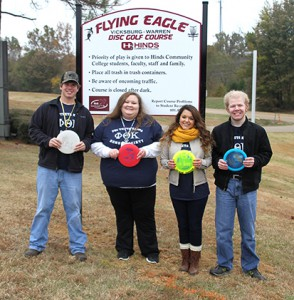 Vicksburg-Warren Campus PTK students gather around the new disc golf course. From left, Joshua Masterson, Haley Harmon, Tiffany Carroll and Thomas Dabney.