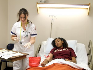 Hinds Community College Practical nursing students Kalia McDowell, left, and Raveen Wilson, both of Vicksburg, do a demonstration at the Jan. 24 at the Vicksburg Nursing Showcase.