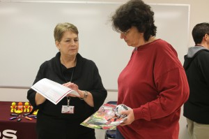 Jane Skinner, director of the nursing program at Hinds Community College's Vicksburg-Warren Campus, talks with Wanda Vines of Vicksburg at the Jan. 24 nursing showcase.