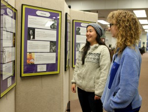 """Hinds Community College students Aygul Brown of Yazoo City, left, and Taylor Stockton of Cleveland check out the """"Inspiring the Next Generation: Exceptional Mississippi Women""""  photo exhibit at the McLendon Library on the Raymond Campus."""