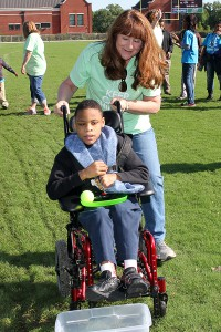 Rene Layman, Hinds County school district reading interventionist, helps Bolton-Edwards student Gerrick Haley, 12, play a relay game.