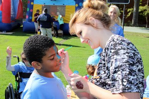 Adrian Ramos, 11, Raymond Elementary gets his face painted by Jessa Shivers, a Hinds Community College student in the physical therapy assistant program at Jackson Campus-Nursing/Allied Health Center.