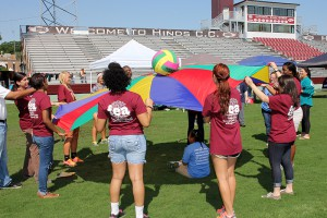 Hinds Community College Future Educators of America students bounce a ball on a parachute as one of the activities with the special education students.