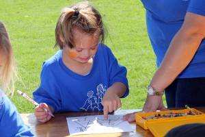 Gary Road Elementary student Kassidy Furlow, 5, does an art project at field day at Hinds Community College.