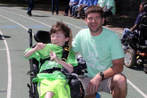 Byram Middle coach Robert Pittman, a Hinds alumnus, and Brannon Martin are the winners of the field day wheelchair race.