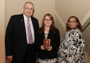 Lacey Bagley, of Crystal Springs, center, was among Hinds Community College students recently recognized with a departmental award in a program April 17 at Cain-Cochran Hall on the Raymond Campus. Bagley received the Respiratory Care Technology Award presented by Respiratory Therapy Instructor Stephanie Jones, right, and Hinds Community College President Dr. Clyde Muse.
