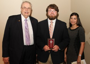 Elijah Beatty, of Pearl, center, was among Hinds Community College students recently recognized with a departmental award in a program April 17 at Cain-Cochran Hall on the Raymond Campus. Beatty received an Outstanding Student Award for education, presented by Reading Instructor Jennifer Rodgers, right, and Hinds Community College President Dr. Clyde Muse.