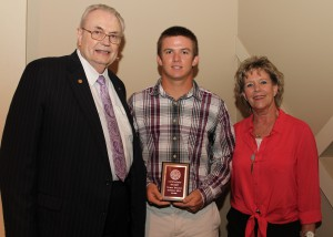 Randall Bell, of Woodville, center, was among Hinds Community College students recently recognized with a departmental award in a program April 17 at Cain-Cochran Hall on the Raymond Campus. Bell received an Outstanding Student Award for physical education, presented Physical Education Instructor Terri Black, right, and Hinds Community College President Dr. Clyde Muse.