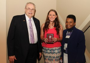 Adrian Brewer, of Mendenhall, center, was among Hinds Community College students recently recognized with a departmental award in a program April 17 at Cain-Cochran Hall on the Raymond Campus. Brewer received an Outstanding Student Award for dental assisting, presented by Reading and Dental Assistant Instructor Valeria Winston, right, and Hinds Community College President Dr. Clyde Muse.