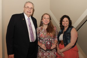 Jessica Cade, of Vicksburg, center, was among Hinds Community College students recently recognized with a departmental award in a program April 17 at Cain-Cochran Hall on the Raymond Campus. Cade received an Outstanding Student Award for emergency medical science-paramedic, presented by Emergency Medical Science Instructor Patricia Dawson, right, and Hinds Community College President Dr. Clyde Muse.