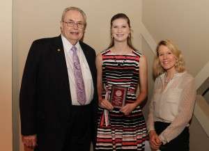 Kaylee Crosby, of Pearl, center, was among Hinds Community College students recently recognized with a departmental award in a program April 17 at Cain-Cochran Hall on the Raymond Campus. Crosby received an Outstanding Student Award for psychology, presented by Psychology Instructor Susan Ringer, right, and Hinds Community College President Dr. Clyde Muse.