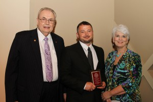 Joseph Easterling, of Morton, center, was among Hinds Community College students recently recognized with a departmental award in a program April 17 at Cain-Cochran Hall on the Raymond Campus. Easterling received an Outstanding Student Award for associate degree nursing, presented by Nursing Learning Lab Instructor Cynthia Casey, right, and Hinds Community College President Dr. Clyde Muse.