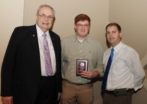 Zachary Furlow, of Raymond, center, was among Hinds Community College students recently recognized with a departmental award in a program April 17 at Cain-Cochran Hall on the Raymond Campus. Furlow received an Outstanding Student Award for chemistry, presented by Chemistry Instructor Jason Webb, right, and Hinds Community College President Dr. Clyde Muse.