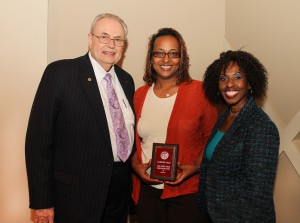Farisa Seconda Husband, of Vicksburg, center, was among Hinds Community College students recently recognized with a departmental award in a program April 17 at Cain-Cochran Hall on the Raymond Campus. Husband received the ASG Leadership Award for the Nursing/Allied Health Center, presented by Audrey Murray, right, and Hinds Community College President Dr. Clyde Muse.