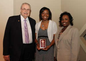 Larita Johnson, of Jackson, center, was among Hinds Community College students recently recognized with a departmental award in a program April 17 at Cain-Cochran Hall on the Raymond Campus. Johnson received an Outstanding Student Award for hospitality and tourism management, presented by Assistant Dean for Career and Technical Education Angela Griffin, right, and Hinds Community College President Dr. Clyde Muse.