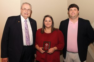 Aleah Lick, of Vicksburg, center, was among Hinds Community College students recently recognized with a departmental award in a program April 17 at Cain-Cochran Hall on the Raymond Campus. Lick received an Outstanding Student Award for business administration, presented by Counselor Cooper McCachren, right, and Hinds Community College President Dr. Clyde Muse.