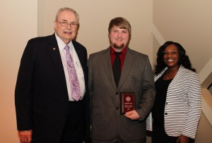Charles Lowery, of Florence, center, was among Hinds Community College students recently recognized with a departmental award in a program April 17 at Cain-Cochran Hall on the Raymond Campus. Lowery received the ASG Leadership Award for the Rankin Campus, presented by reading instructor Vanda Brumfield, right, and Hinds Community College President Dr. Clyde Muse.