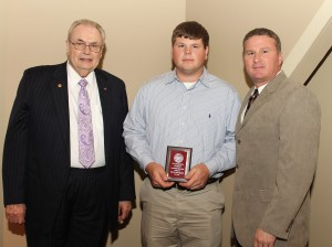 Phillip Wade Means, of Brandon, center, was among Hinds Community College students recently recognized with a departmental award in a program April 17 at Cain-Cochran Hall on the Raymond Campus. Means received an Outstanding Student Award for agribusiness management technology, presented by Agribusiness Technology Instructor Wayne Boshart, right, and Hinds Community College President Dr. Clyde Muse.