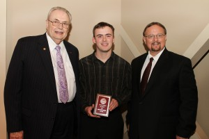 Asher William Mitchell, of Silver Creek, center, was among Hinds Community College students recently recognized with a departmental award in a program April 17 at Cain-Cochran Hall on the Raymond Campus. Mitchell received an Outstanding Student Award for music, presented by Music Instructor Randy Mapes, right, and Hinds Community College President Dr. Clyde Muse.