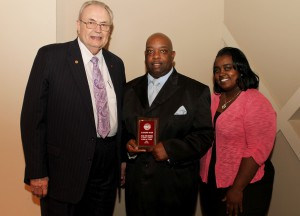 Abram Andre Muhammad, of Jackson, center, was among Hinds Community College students recently recognized with a departmental award in a program April 17 at Cain-Cochran Hall on the Raymond Campus. Muhammad received the ASG Leadership Award for the Jackson Academic/Technical Center, presented by Paralegal Technology Instructor Shivochie Dinkins, right, and Hinds Community College President Dr. Clyde Muse.