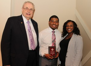 Stephen Nathaniel Murrell, of Vicksburg, center, was among Hinds Community College students recently recognized with a departmental award in a program April 17 at Cain-Cochran Hall on the Raymond Campus. Kirby received the ASG Leadership Award for the Raymond Campus, presented by reading instructor Vanda Brumfield, right, and Hinds Community College President Dr. Clyde Muse.
