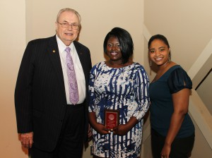 Alexis Chante Noble, of Vicksburg, center, was among Hinds Community College students recently recognized with a departmental award in a program April 17 at Cain-Cochran Hall on the Raymond Campus. Noble received an Outstanding Student Award for fashion merchandising, presented by Overload Instructor Ebony Robinson, right, and Hinds Community College President Dr. Clyde Muse.