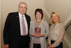Jodie Ortner, of Jackson, center, was among Hinds Community College students recently recognized with a departmental award in a program April 17 at Cain-Cochran Hall on the Raymond Campus. Ortner received an Outstanding Student Award for child development technology, presented by Psychology Instructor Susan Ringer, right, and Hinds Community College President Dr. Clyde Muse.