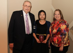 Huiping Qi, of Brandon, center, was among Hinds Community College students recently recognized with a departmental award in a program April 17 at Cain-Cochran Hall on the Raymond Campus. Qi received an Outstanding Student Award from the Reading Department, presented by Reading and Education Instructor Cassandra Varnell, right, and Hinds Community College President Dr. Clyde Muse.