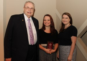 Sandy Miranda Schiappa, of Pearl, center, was among Hinds Community College students recently recognized with a departmental award in a program April 17 at Cain-Cochran Hall on the Raymond Campus. Schiappa received an Outstanding Student Award for paralegal technology presented by Paralegal Technology Instructor Kathryn G. Ford, right, and Hinds Community College President Dr. Clyde Muse.