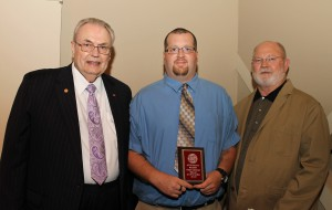 Kyle Swanson, of Raymond, center, was among Hinds Community College students recently recognized with a departmental award in a program April 17 at Cain-Cochran Hall on the Raymond Campus. Townsend received an Outstanding Student Award for aviation maintenance technology, presented by Business Administration Instructor Marion Eifling, right, and Hinds Community College President Dr. Clyde Muse.
