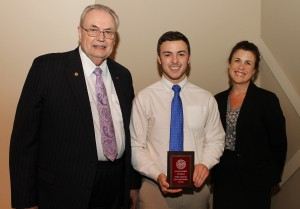 Dallas Lee Townsend, of Raymond, center, was among Hinds Community College students recently recognized with a departmental award in a program April 17 at Cain-Cochran Hall on the Raymond Campus. Townsend received an Outstanding Student Award for business administration, presented by Business Administration Instructor Tracy Morgan, right, and Hinds Community College President Dr. Clyde Muse.