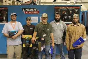 Hinds CC welding students Nathan Lantrip, from left, Matthew Brown, James M. Franklin, Jody Jones and Tony Kaho hold prizes won during a welding competition held Thursday at the Career and Technical Building at the Rankin Campus.