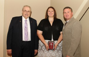 Joleigh Anna Wilkes, of Noxapater, center, was among Hinds Community College students recently recognized with a departmental award in a program April 17 at Cain-Cochran Hall on the Raymond Campus. Wilkes received an Outstanding Student Award for agriculture, presented by Agribusiness Technology Instructor Wayne Boshart, right, and Hinds Community College President Dr. Clyde Muse.