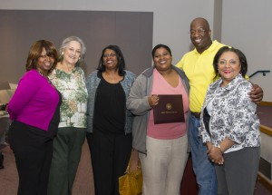 Ashley Louis of Jackson is the winner of the annual Carla McCulloch Scholarship for nursing students at Hinds Community College. From left are Rosalind Ratcliff, Hinds clinical instructor; Dene Bass-Cook, retired Hinds instructor who presented the scholarship; Louis' mother, Margie Davis; Ashley Louis, her husband Charles Buck; and Dr. Irish Patrick-Williams, Hinds instructor.