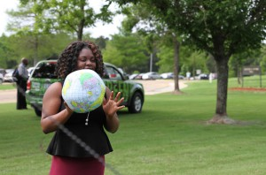 Jasmine McGee of Jackson attempts to make the Earth ball into the recycling bin to win candy during Earth Day at the Hinds Community College Rankin Campus.