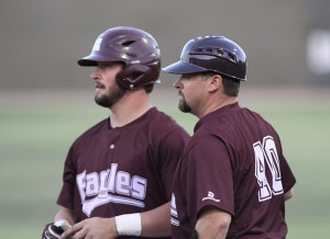 No. 40 volunteer baseball coach Tim Axton of Brandon with Hinds Community College baseball player Marshall Boggs at the spring 2014 College World Series in Enid, Okla.
