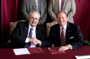 Hinds Community College President Dr. Clyde Muse and Mississippi State University Dr. Mark Keenum shake after signing a 2 plus 2 agreement for Precision Agriculture on April 9.
