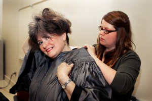 Cynthia Hollingsworth, left, gets help adjusting her gown from Haley Hartfield before commencement exercises at Cain-Cochran Hall May 15. Hollingsworth, of Florence, earned an Associate's of Arts and plans to pursue a nursing degree from Belhaven.