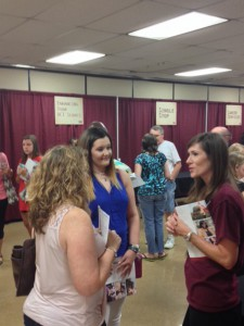 Annalese Burton, center, a senior at Philadelphia High School, and her mother, Crystal, talk with District Director of Enrollment Services Kathryn Cole at the Nursing and Allied Health Showcase Tuesday, Sept. 8, 2015 at Hinds' Jackson Campus-Nursing Allied Health Center.