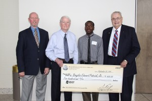 MDOT Human Resources Division Training Manager and Scholarship Coordinator Terry Winstead, Transportation Commissioner Dick Hall, Douglas Edward Patrick Jr. and Hinds Community College President Dr. Clyde Muse at the Clyde Muse Center on the Rankin Campus of Hinds Community College in Pearl.