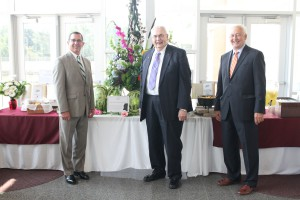 Jim Walt, CEO of Valley Services, left, Hinds President Dr. Clyde Muse, center, and George Ardelean, Valley Services' executive vice president for dining and health services, stand during a break at the Winter-Reed Partnership Award ceremony. Valley catered the event Sept. 1 that honored Dr. Muse.