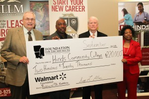 Dr. Clyde Muse, from left, Tice White, of the Walmart Foundation, Dick Hall, Transportation Commissioner for the Central District and Ivye Allen, president of the Foundation for the Mid South, hold a ceremonial check signifying a $220,000 gift to Hinds from the Walmart Foundation to train more women truck drivers.